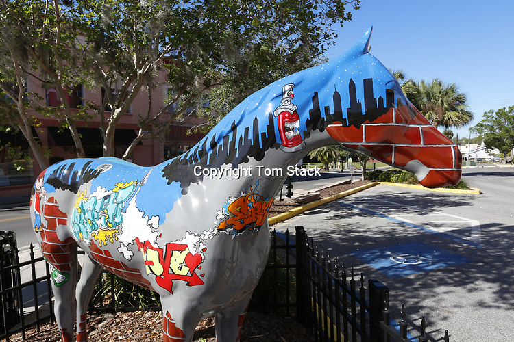 """A beautiful painted horse sculpture, part of Horse Fever, a public art project of painted horses by the Marion Cultural Alliance in Ocala, Florida. This horse is titled """"Urban Art"""" by artist Kayleb Higgins and is loan to the City of Ocala for public display by Harvey Vandevan, John Alvarez and Tom Ingram."""