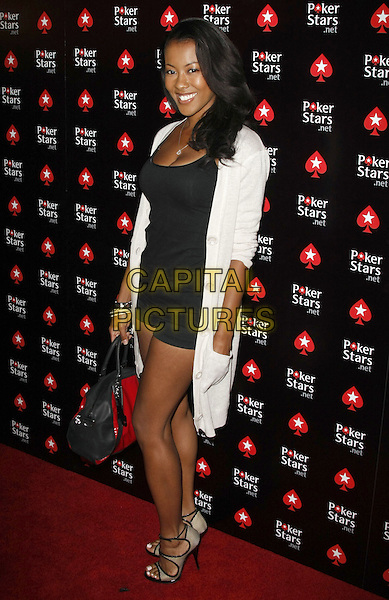 DENYCE LAWTON .PokerStars.net Burlesque Party to celebrate the World Series of Poker at Rain Night Club held inside the Palms Hotel and Casino, Las Vegas, Nevada, USA, 7 July 2008.full length black dress white cardigan long  bag heels lace up shoes .CAP/ADM/MJT.©MJT/Admedia/Capital Pictures
