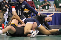 PHILADELPHIA, PA - MARCH 18: Quentin Wright of Penn State University pins Grant Gambrall of the University of Iowa during their 184 pound semi-final match as head coach Cael Sanderson looks on during the NCAA Wrestling Championships on March 18, 2011 at the Wells Fargo Center in Philadelphia, Pennsylvania. (Photo by Hunter Martin/Getty Images) *** Local Caption *** Quentin Wright;Grant Gambrall;Cael Sanderson