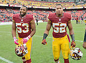 Washington Redskins linebacker Mason Foster (53) and Washington Redskins inside linebacker Keenan Robinson (52) leave the field following their team's 23-20 victory the Philadelphia Eagles at FedEx Field in Landover, Maryland on October 4, 2015. <br /> Credit: Ron Sachs / CNP