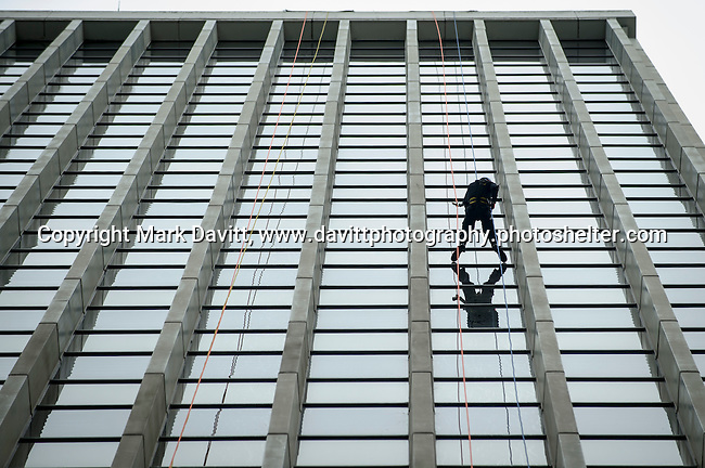 """Captain Amy Kramer from the Pleasant Hill Police Department went """"Over the Edge"""" of the 345-ft. Financial Center in Des Moines in support of Special Olympics Iowa Oct. 26."""