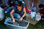 Andean Mountain Cat (Leopardus jacobita) biologist, Cintia Tellaeche, packing gear for the field, Jujuy, Argentina