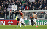 Calcio, andata degli ottavi di finale di Champions League: Juventus vs Bayern Monaco. Torino, Juventus Stadium, 23 febbraio 2016. <br /> Juventus' goalkeeper Gianluigi Buffon, left, greets his teammate Stefano Sturaro as their teammate Paulo Dybala greets fans at the end of the Champions League round of 16 first leg soccer match between Juventus and Bayern at Turin's Juventus Stadium, 23 February 2016. The game ended 2-2.<br /> UPDATE IMAGES PRESS/Isabella Bonotto