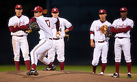STANFORD, CA - March 25, 2011: A.J. Vanegas of Stanford baseball warms up while his infield watches during Stanford's game against Long Beach State at Sunken Diamond. Stanford lost 6-3.