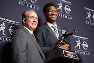 Jameis Winston holds the 2013 Heisman Memorial Trophy as he poses for a photo with Florida State Seminoles head coach Jimbo Fisher.   (Photo by Don Baxter/Media Images International) New York City,  - December 14,  2013