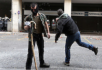 Pictured: Two farmers throw stones to riot police officers Friday 12 February 2016<br /> Re: Violent clashes between farmers and riot police outside the Ministry of Agricultural Development in Athens, Greece. The farmers travelled from Crete to protest against pension and welfrae reforms proposed by the Greek government,