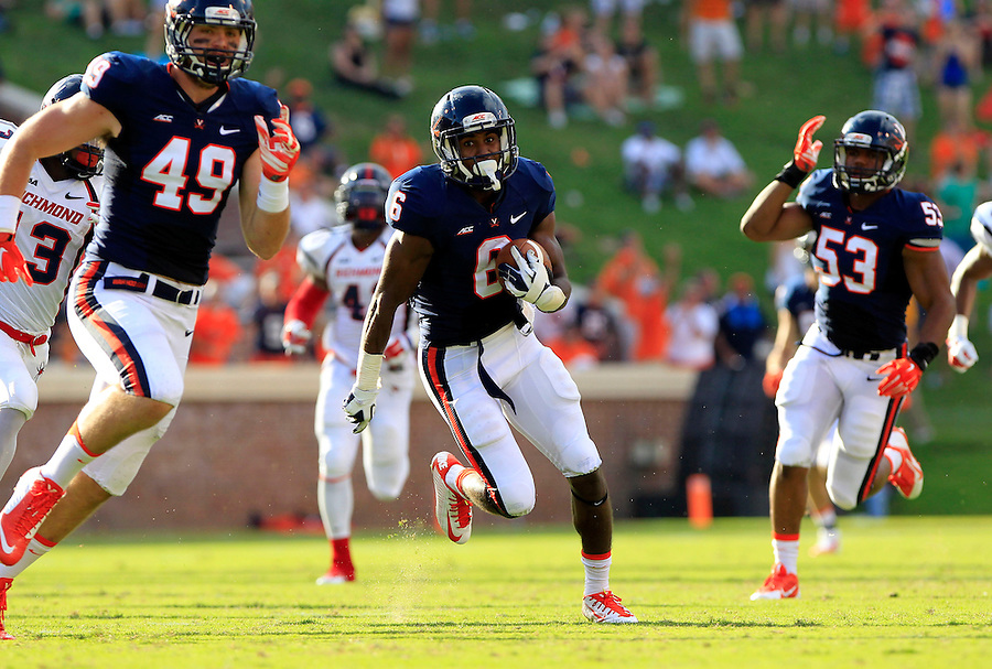 Virginia wide receiver Darius Jennings (6) runs between Virginia tight end Zachary Swanson (49) and Virginia linebacker Micah Kiser (53) on a long third quarter punt return Saturday Sept. 6, 2014 at Scott Stadium in Charlottesville, VA. Virginia defeated Richmond 45-13. Photo/Andrew Shurtleff