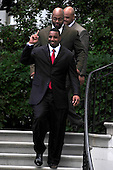"Chris Canty Flashes a ""number one"" sign as he arrives for the ceremony where United States President Barack Obama welcomed the Super Bowl Champion New York Giants to the White House in Washington, D.C. on Friday, June 8, 2012..Credit: Ron Sachs / CNP.(RESTRICTION: NO New York or New Jersey Newspapers or newspapers within a 75 mile radius of New York City)"