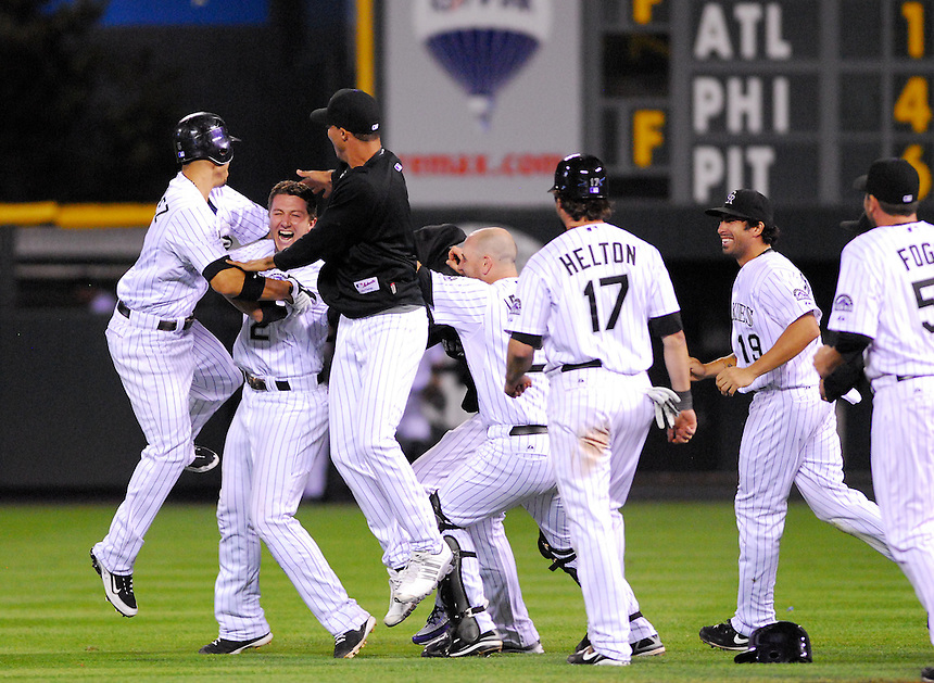 August 25, 2009: Rockies shortstop Troy Tulowitzki celebrates with his teammates (From left, Carlos Gonzalez, Tulowitzki, Ubaldo Jimenez, Chris Iannetta, Todd Helton, Ryan Spilborghs, and Josh Fogg) after hitting the game-winning walk off base hit during a regular season game between the Los Angeles Dodgers and the Colorado Rockies at Coors Field in Denver, Colorado. The Rockies beat the Dodgers 5-4 in 10 innings. *****For editorial use only*****