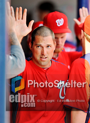 10 March 2012: Washington Nationals' infielder Mark DeRosa returns to the dugout after scoring against the New York Mets at Space Coast Stadium in Viera, Florida. The Nationals defeated the Mets 8-2 in Grapefruit League play. Mandatory Credit: Ed Wolfstein Photo