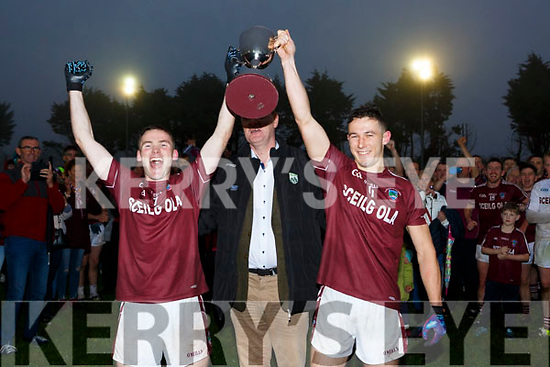 Padraig Jackie O'Sullivan and Chris Farley Dromid celebrate after winning  the Junior County Championship final in Killorglin on Saturday