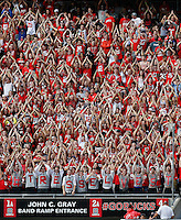 Ohio State students pay homage to former coach Jim Tressel during the second quarter of the NCAA football game against the Northern Illinois Huskies at Ohio Stadium in Columbus on Sept. 19, 2015. (Adam Cairns / The Columbus Dispatch)