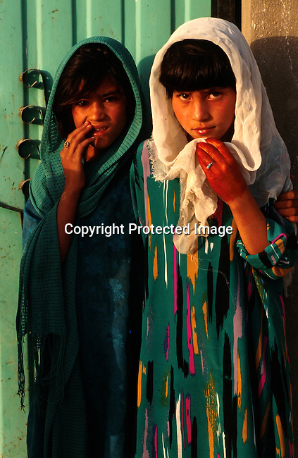 Girls in Kandaha, Afghanistan. The Taliban took over most of Afghanistan in 1996, and have forced the people to live under strict muslim law. Girls are not allowed to attend schools and women are not allowed to work. .©Per-Anders Pettersson/iAfrika Photos