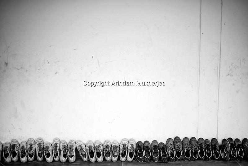Practice boots lined up at the corridor of Sukma Football Academy. Sukma, Chattisgarh, India. Arindam Mukherjee.