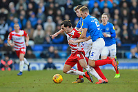 John Marquis of Doncaster Rovers is tackled by Matthew Clarke and Dion Donohue of Portsmouth during Portsmouth vs Doncaster Rovers, Sky Bet EFL League 1 Football at Fratton Park on 2nd February 2019