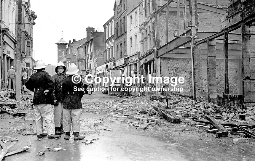 Main Street, Portrush, Co Antrim, N Ireland - mopping up after an overnight bombing blitz by the Provisional IRA. The IRA's 8 bombs were at the height of the popular resort's holiday season. 4th August 1976. 197608040336a<br />