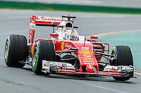 March 18, 2016: Sebastian Vettel (DEU) #5 from the Scuderia Ferrari team rounds turn 2 during practise session one at the 2016 Australian Formula One Grand Prix at Albert Park, Melbourne, Australia. Photo Sydney Low