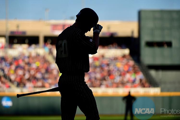 22 JUNE 2015:  Bryan Reynolds (20) of Vanderbilt University tips his cap to the umpire during the Division I Men's Baseball Championship held at TD Ameritrade Park in Omaha, NE.  Vanderbilt defeated Virginia 5-1 in game one of the best of three series.  Jamie Schwaberow/NCAA Photos