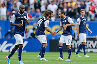 Chicago, IL - Sunday July 28, 2013:   USMNT forward Landon Donovan (10) celebrates with teammates after assisting a goal to Brek Shea (23) is scored during the CONCACAF Gold Cup Finals soccer match between the USMNT and Panama, at Soldier Field in Chicago, IL.