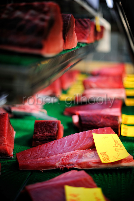 Blocks of blue fin tuna is lined up on the refrigerator of a retailer at the world's largest fish and marine products market in Tsukiji, Tokyo on Monday 30 March 2009.