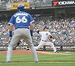 (R-L) Masahiro Tanaka (Yankees), Munenori Kawasaki (Blue Jays),<br /> SEPTEMBER 21, 2014 - MLB :<br /> Masahiro Tanaka of the New York Yankees pitches during the Major League Baseball game against the Toronto Blue Jays at Yankee Stadium in Bronx, New York, United States. (Photo by AFLO)