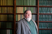 Kevin O'Neill is an Associate Professor of History and co-founder and former director of the Irish Studies Program at Boston College in Chestnut Hill, Massachusetts, USA. He is photographed here in the library in Boston College's Connolly House, which houses the Irish Studies Program and other Irish programs at the school.
