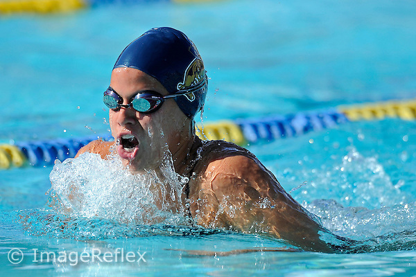5 January 2013:  FIU's Melissa Moreno competes in the 100 yard breaststroke as the FIU Golden Panthers hosted the annual FIU Winter Invitational meet at the Biscayne Bay Campus Aquatics Center in Miami, Florida.