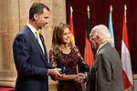 Spain's Crown Prince Felipe (L) and Princess Letizia give a medal to Belgian scientist Francois Englert, one of the laureates of the 2013 Prince of Asturias Award for Technical and Scientific Research, during an official audience at the Reconquista Hotel in Oviedo, Spain. October 25, 2013..(ALTERPHOTOS/Victor Blanco)