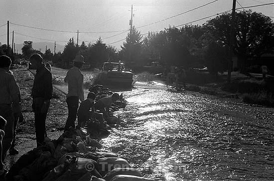 truck, water, sandbags during flood.<br />