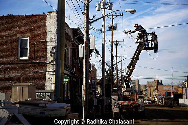 ROCKAWAY PARK, NEW YORK-NOVEMBER 01: Lights are repaired on Rockaway Beach Boulevard after Hurricane Sandy November 1, 2012 in this Queens neighborhood devastated by the storm. A large number of homes and businesses were destroyed and much of the area is without power.