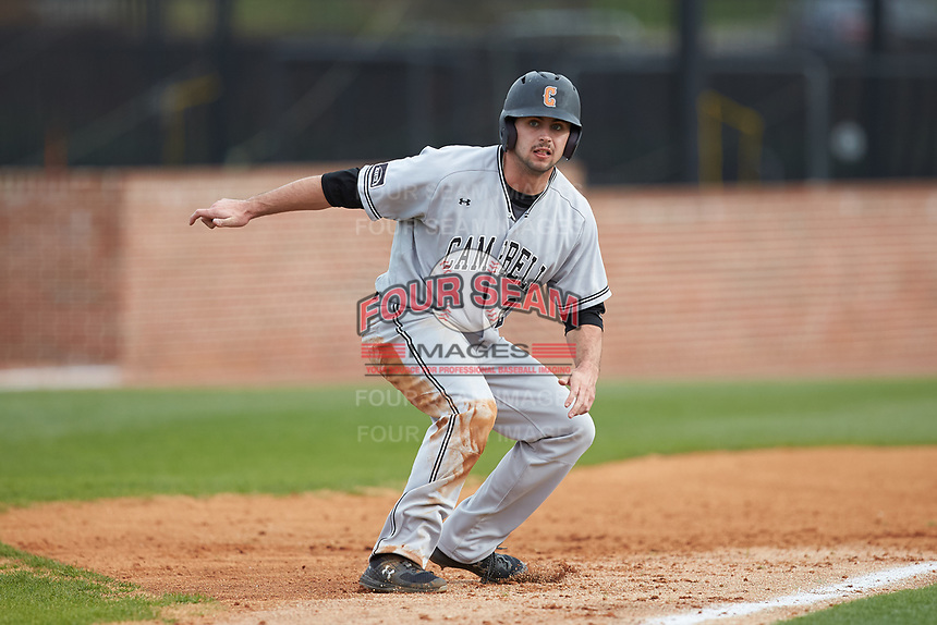 Matthew Barefoot (28) of the Campbell Camels takes his lead off of third base against the High Point Panthers at Williard Stadium on March 16, 2019 in  Winston-Salem, North Carolina. The Camels defeated the Panthers 13-8. (Brian Westerholt/Four Seam Images)