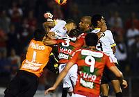 SAO PAULO SP, 31 Julho 2013 - PORTUGUESA  X CRICIUMA -  jogadores da Portuguesa em dividida durante partida contra o Criciuma valida pelo campeonato brasileiro de 2013  no Estadio do Caninde em  Sao Paulo, nesta quarta, 31. (FOTO: ALAN MORICI / BRAZIL PHOTO PRESS).