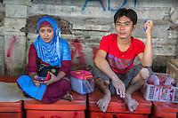 Bali, Indonesia.  Man and Woman in the Jimbaran Fish Market.