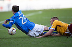 Motherwell v St Johnstone...31.01.15    SPFL<br /> Louis Laing brings down Chris Kane for which his sent off<br /> Picture by Graeme Hart.<br /> Copyright Perthshire Picture Agency<br /> Tel: 01738 623350  Mobile: 07990 594431