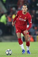 27th November 2019; Anfield, Liverpool, Merseyside, England; UEFA Champions League Football, Liverpool versus SSC Napoli ; Virgil van Dijk of Liverpool controls the ball in the centre circle - Editorial Use