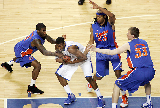 Freshman guard John Wall fights Florida's defense in the first half of UK's win over Florida at Rupp Arena on Sunday, March 7, 2010. Photo by Britney McIntosh | Staff