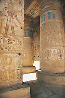 Columns that might have been painted in the twelfth century BC still retain much of their vibrant colour today. The hypostyle hall in Medinat Habu, the walled city that was built as a power base by Ramses III, the last of the great Pharoahs of Egypt, during his reign from 1184 to 1153 BC.