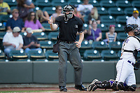 Home plate umpire Andy Stukel makes a strike call during the Carolina League game between the Buies Creek Astros and the Winston-Salem Dash at BB&T Ballpark on June 23, 2017 in Winston-Salem, North Carolina.  The Astros defeated the Dash 3-0.  (Brian Westerholt/Four Seam Images)