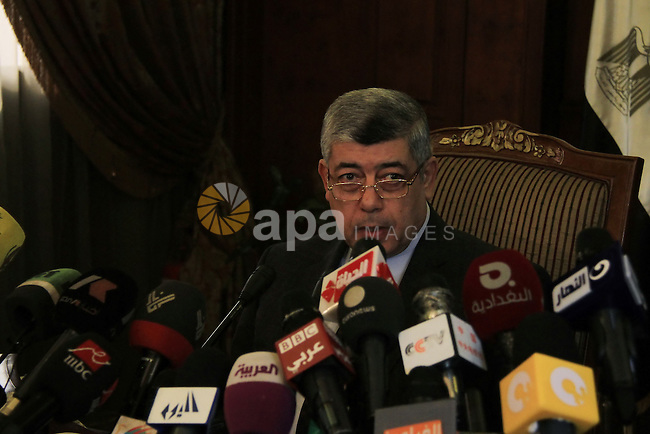 Egyptian Interior Minister Mohamed Ibrahim speaks to media during a press conference, in Cairo on January 02, 2014. Egyptian Interior Minister on Thursday said that a suicide car bombing that targeted a police headquarters last month was carried out by a militant Islamist, with involvement from the Muslim Brotherhood. Photo by Mohammed Bendari