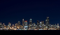 The Seattle skyline is shown from across Elliot Bay in Seattle Washington.