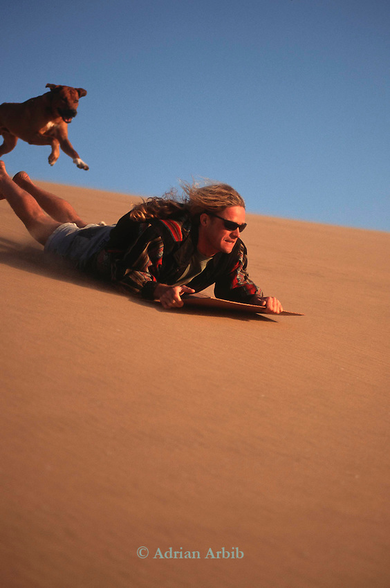 Sand-boarding on sand dunes, Namib Naukluft desert