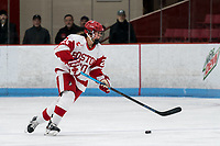 BOSTON, MA - FEBRUARY 16: Grace Parker #20 of Boston University brings the puck forward during a game between University of New Hampshire and Boston University at Walter Brown Arena on February 16, 2020 in Boston, Massachusetts.