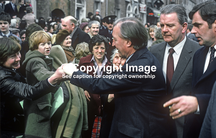 Charles Haughey, incoming Taoiseach, Prime Minister, Rep of Ireland, greets supporters after emerging from a Special Mass at the Pro Cathedral, Dublin, to mark the start of the 23rd Dail Eireann. 19820300040CH4.<br /> <br /> Copyright Image from Victor Patterson,<br /> 54 Dorchester Park, <br /> Belfast, UK, BT9 6RJ<br /> <br /> t1: +44 28 9066 1296 (from Rep of Ireland 048 9066 1296)<br /> t2: +44 28 9002 2446 (from Rep of Ireland 048 9002 2446)<br /> <br /> m: +44 7802 353836<br /> <br /> e: victorpatterson@me.com<br /> www.victorpatterson.com<br /> <br /> Please see my Terms and Conditions of Use at www.victorpatterson.com. It is IMPORTANT that you familiarise yourself with them.<br /> <br /> Images used on the Internet must be visibly watermarked i.e. &copy; Victor Patterson<br /> within the body of the image and copyright metadata must not be deleted. Images <br /> used on the Internet have a size restriction of 4kbs and will be chargeable at current<br />  NUJ rates unless agreed otherwise.<br /> <br /> This image is only available for the use of the download recipient i.e. television station, newspaper, magazine, book publisher, etc, and must not be passed on to any third <br /> party. It is also downloaded on condition that each and every usage is notified within 7 days to victorpatterson@me.com<br /> <br /> The right of Victor Patterson to be identified as the author is asserted in accordance with The Copyright Designs And Patents Act (1988). All moral rights are asserted.