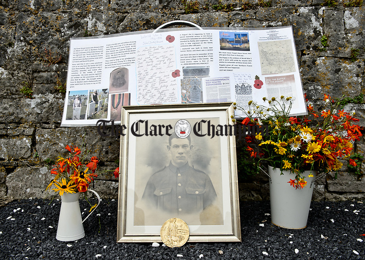 The family grave is decorated at a commemorative service in Kilchreest cemetery to mark the one hundredth anniversary of the death of local man John Jacko Browne who was killed in the First World War and is buried in Saulty, France. Photograph by John Kelly.