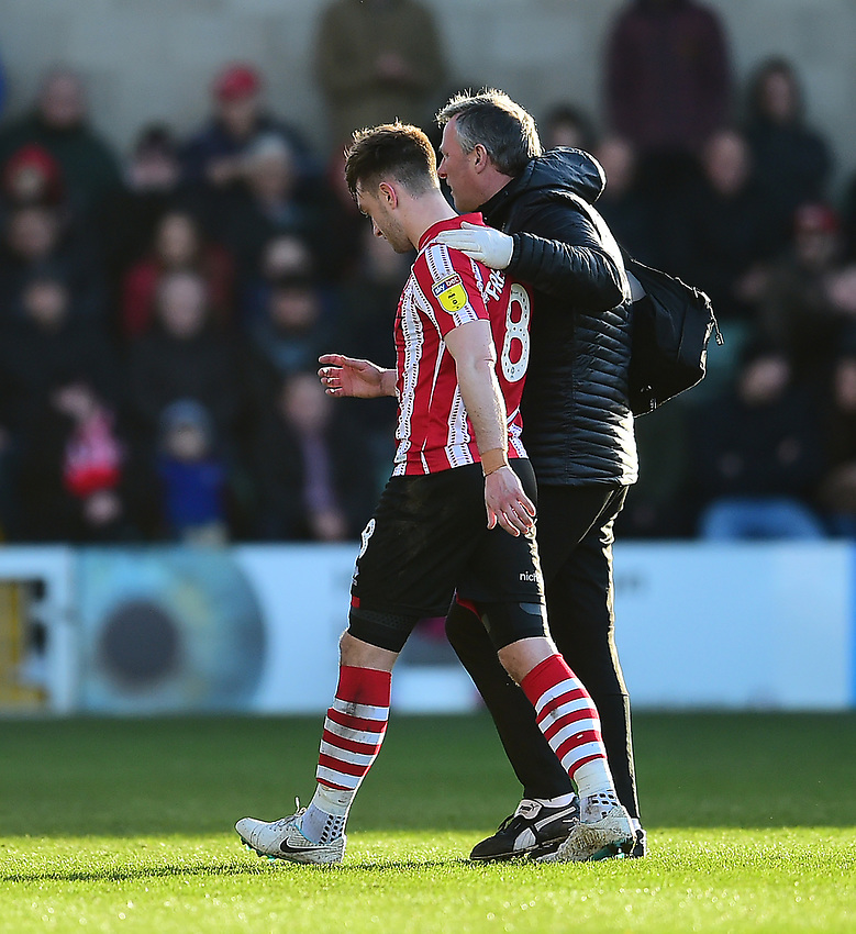Lincoln City's Lee Frecklington leaves the pitch after picking up an injury<br /> <br /> Photographer Andrew Vaughan/CameraSport<br /> <br /> The EFL Sky Bet League Two - Lincoln City v Northampton Town - Saturday 9th February 2019 - Sincil Bank - Lincoln<br /> <br /> World Copyright © 2019 CameraSport. All rights reserved. 43 Linden Ave. Countesthorpe. Leicester. England. LE8 5PG - Tel: +44 (0) 116 277 4147 - admin@camerasport.com - www.camerasport.com