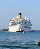 The Costa Fascinosa, a Concordia-class cruise ship, as it sails through the harbor in Venice, Italy on April 14, 2013.  It was constructed by Fincantieri's Marghera shipyard in Venice, Italy.  Its maiden voyage began on May 6, 2012. It can carry up to 3,780 passengers in 1,506 cabins..Credit: Ron Sachs / CNP