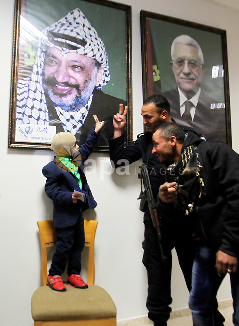 Five-year-old Ahmed Dawabsha, a Palestinian boy who survived a firebombing by Jewish extremists targeting his family home that killed his parents and brother, is seen before his meeting with the governor of the northern Palestinian town of Nablus on March 15, 2016. Ahmed Dawabsha, his uncle and his grandparents were to fly from the Jordanian capital Amman to Spain to meet Real Madrid stars including his idol Cristiano Ronaldo, his grandfather said. The July 31, 2015 attack on the Dawabsha family home in the village of Duma in the occupied West Bank killed 18-month-old Ali Saad Dawabsha and fatally wounded his parents. Ahmed, who was hospitalised after the attack with severe burns, was the sole survivor from the immediate family. Photo by Nedal Eshtayah