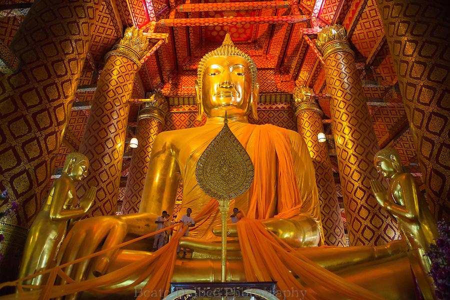 changing the Buddha's robe, Wat Phananchoeng, Ayutthaya, Thailand