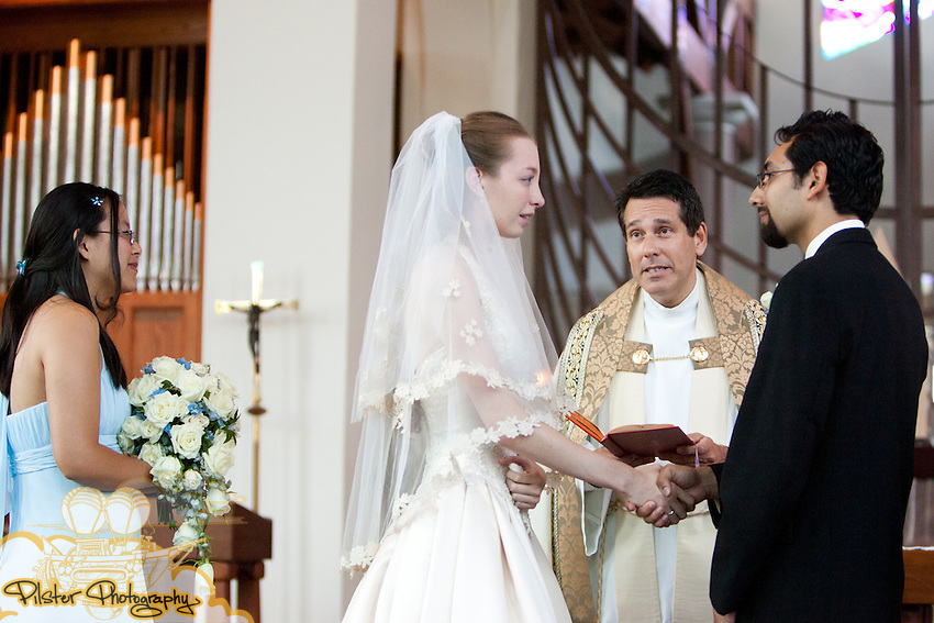 Rebecca Fraley and Gian-Karlo Alvarez during their wedding on Saturday, May 28, 2011, at Sts. Peter and Paul Catholic Church in Winter Park, Florida. (Chad Pilster, Pilster Photography http://www.PilsterPhotography.net)