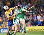 Aron Shanagher of Clare in action against Nickie Quaid and Richie McCarthy of Limerick during their Munster Championship semi-final at Thurles.  Photograph by John Kelly.